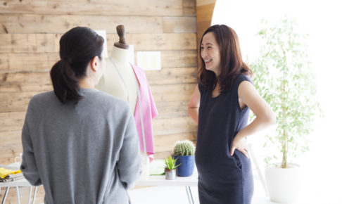 Pregnant fashion designer and manager